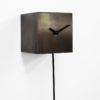 designové kyvadlové hodiny z limitované edice Bronzo s kovovým povrchem